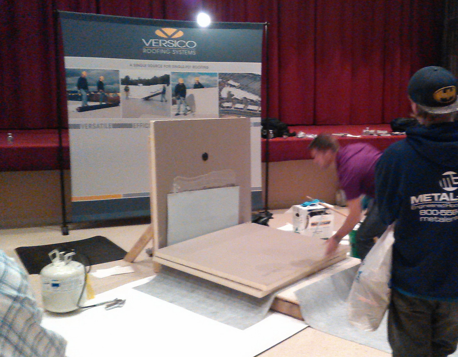 Roofing manufacturers attending a trade show